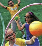 Children playing the game from the Harry Potter movies, Quidditch. Photo (C) Better Homes & Gardens
